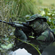 U.s. Navy Seal Crosses Through A Stream Poster