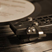 Vinyl Record Playing On A Turntable In Sepia Poster