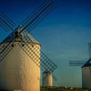 Windmills Under Blue Sky Poster