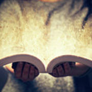 Woman Holding An Open Book Bursting With Light. Poster
