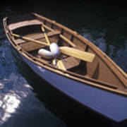Wooden Boat And Paddles In Halibut Cove Poster