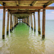 Wooden Pier Stretching Into The Sea Poster