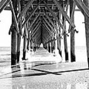 Wooden Post Under A Pier On The Beach Poster