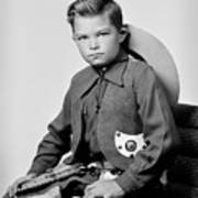 Young Cowboy Sitting Poster
