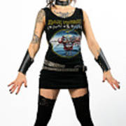 Young Heavy Metal Female Punk Fan Standing Tall With Horns Pierc Poster