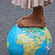Young Woman Standing On Globe Poster