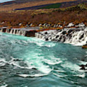 The Beautiful Cascades Of Hraunfossar In Iceland. Poster