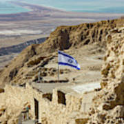An Israeli Flag Flies Near The Entrance To The Top Of Masada In  Poster