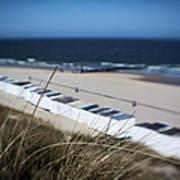 Beach Huts On A Sandy Beach Poster