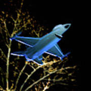 F 16 Lit Up At Night On Glass Monument Poster