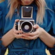 Girl In Vintage Blue Dress Holding Old Poster