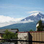 Mount Fuyji From A Distance With Clouds Around It Poster