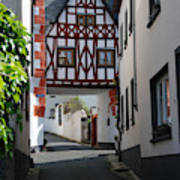 old historic street and woodframed house in Ediger Germany Poster