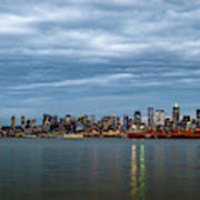 Panorama Of Seattle Skyline At Night With Storm Clouds Poster