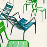 Parisian Metallic Chairs In The City Poster