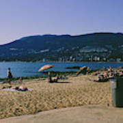 photograph of thid beach which is located in Stanley Park Vancouver. Third beach is a popular location for tourists and locals alike. Poster