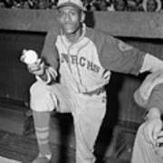 Pitcher Satchel Paige Standing In Dugout Poster