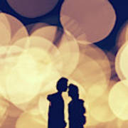 Romantic Couple Kissing On Illuminated Background. Poster