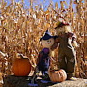 Two Cute Scarecrows With Pumpkins In The Dry Corn Field Poster