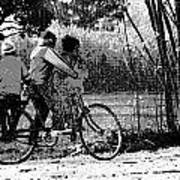 3 Young Children On A Cycle At The Side Of The Road Art Print