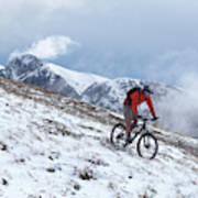 A Mountain Biker Rides Through The Snow Art Print