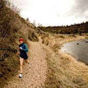 A Woman Jogging On A Dirt Trail Art Print
