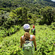 A Young Woman Hikes Through The Jungles Art Print