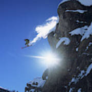 An Extreme Skier Jumps Off A Snowy Art Print