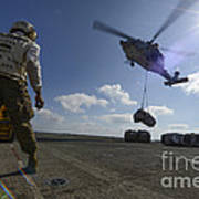 An Mh-60s Sea Hawk Helicopter Lowers Art Print