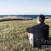 Caucasian Traveler Relaxing On Grass Outdoors Art Print