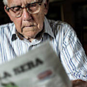 Elderly Man Reading A Newspaper Art Print