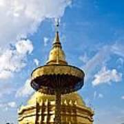 Golden Pagoda With Blue Sky At Wat Phra That Hariphunchai Art Print
