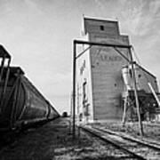 grain elevator and old train track with grain railcars leader Saskatchewan Canada Art Print
