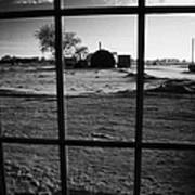 looking out through door window to snow covered scene in small rural village of Forget Saskatchewan  Art Print