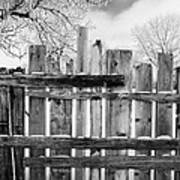 old patched up wooden fence using old bits of wood in snow Forget Saskatchewan Canada Art Print by Joe Fox