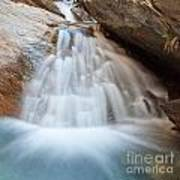 Small Waterfall Casdcading Over Rocks In Blue Pond Art Print