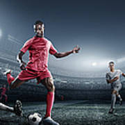 Soccer Player Kicking Ball In Stadium Art Print