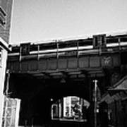 train going over railway bridge elevated section of track southwark London England UK Art Print