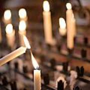 Woman Lighting Prayer Candle Art Print