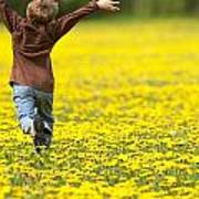 Young Boy Running Through Field Of Art Print