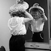 1950s Little Girl Trying On Hat Looking Art Print