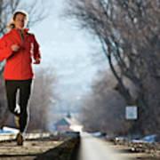 A Woman Running Near A Railroad Track Art Print