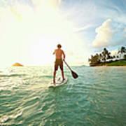 Caucasian Man On Paddle Board In Ocean Art Print