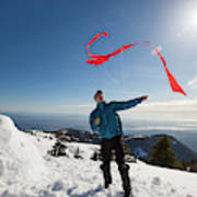 Flying A Kite On A Snowy Mountain Art Print