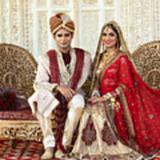 7e84ecad59 Indian Bride And Groom In Traditional Wedding Dress Sitting On A Couch Art  Print