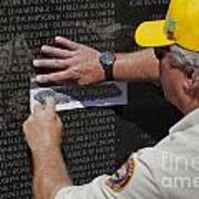 Man Getting A Rubbing Of Fallen Soldier's Name At The Vietnam War Memorial Art Print