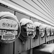 snow covered electricity meters in Saskatoon Saskatchewan Canada Art Print