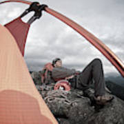A Man Setting Up A Tent Art Print