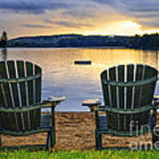 Wooden Chairs At Sunset On Beach Art Print