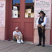 A Dog And A Re-enactor Rest In The Front Of The Bird Cage Theater Tombstone Arizona Art Print